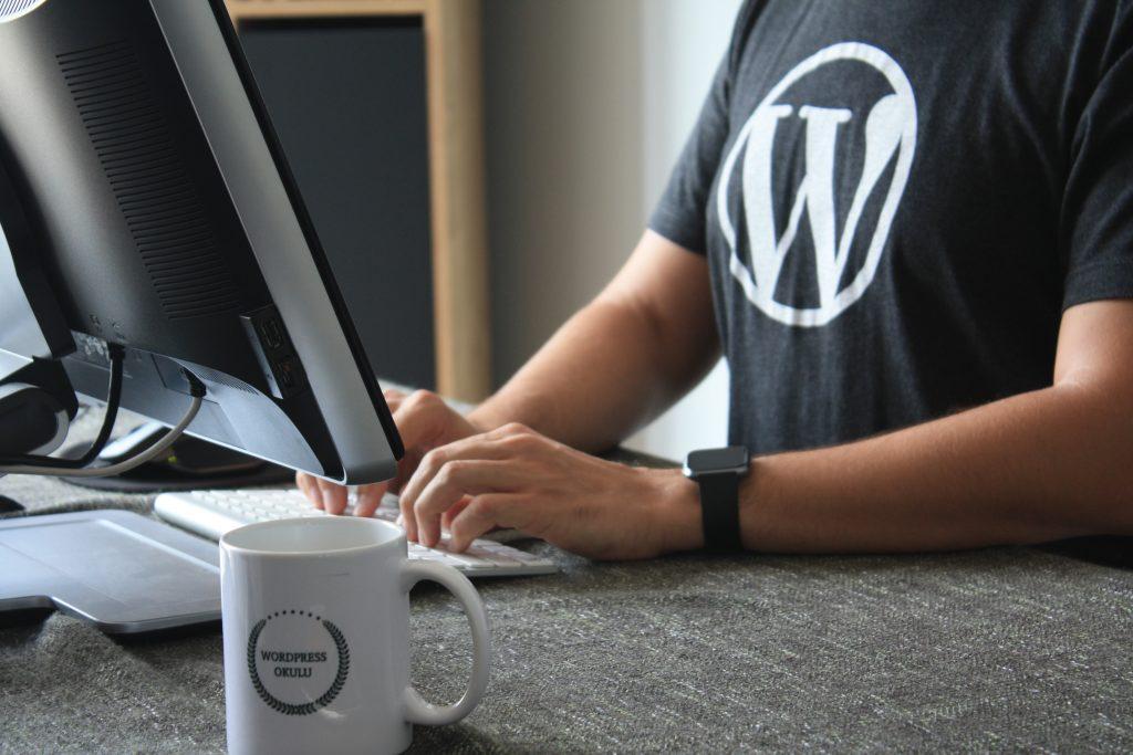 WordPress t-shirt wearer at desk